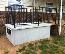 storm shelter safe porch arkansas Nice use of existing feature extension...  Could blend right in with some stain.