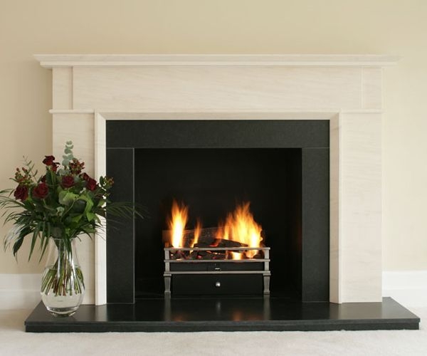 Bespoke Limestone fireplace surround Satin granite slips and hearth Materials and sizes can be altered Designed by Kent Fireplace Company Shown: Bespoke Limestone fireplace surround, satin granite slips and hearth, black metal fire chamber and Gazco Art Deco gas basket