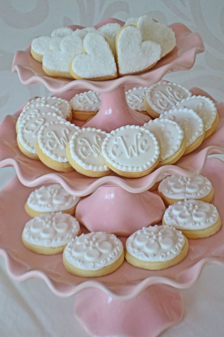Heart Cookies, monogram cookies and cherry blossom cookies on a pink ruffled cake stand. Cookies by Bake Sale Toronto.