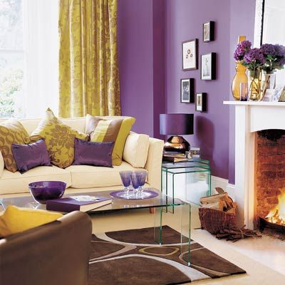 This room's highest-impact design choice is also one of the simplest: a coat of violet paint on the walls. See more in One Living Room, Four Great Designs.   Similar to shown: Cosmic Berry 4001-10C, Valspar.  Via thisoldhouse.com