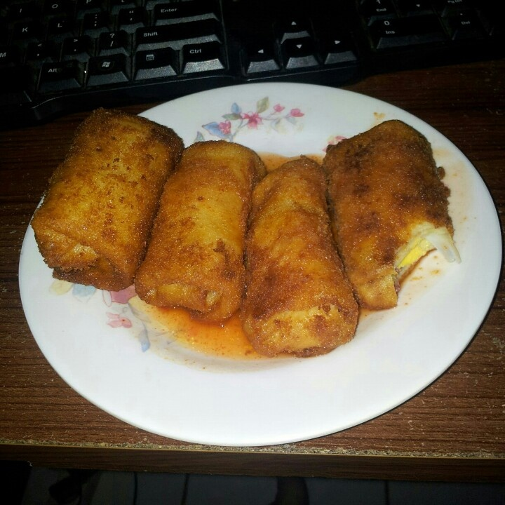 American Risoles (smoked beef and mayo rolls) with tomato sauce.