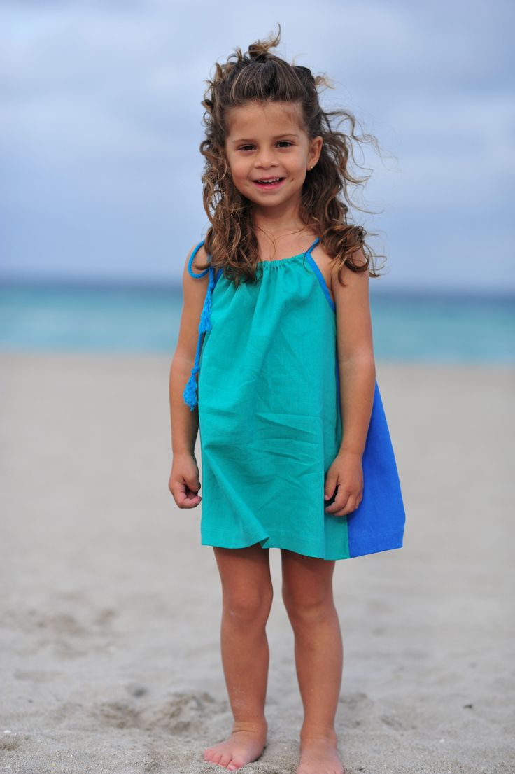 Loire Style Dress- Teal/ Blue. Wear it front or back! with handmade tassels... http://www.creamcoralcollection.com/GIRLS-DRESS-COLOR-BLOCK-FRONT-OR-BACK-p/70007.htm  http://www.creamcoralcollection.com/GIRLS-DRESS-COLOR-BLOCK-FRONT-OR-BACK-p/70007.htm