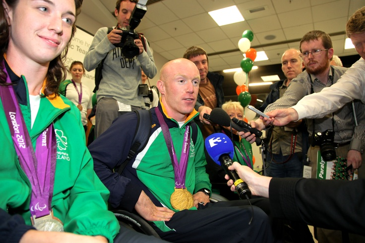 Paralympic double gold medal winner Mark Rohan and equestrian medallist Helen Kearney surrounded by the media at Dublin Airport on Monday, September 10.