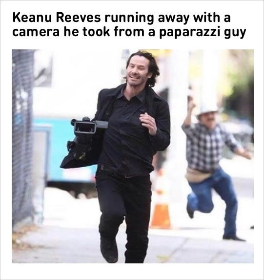 Keanu Reeves running away with camera taken from a paparazi guy