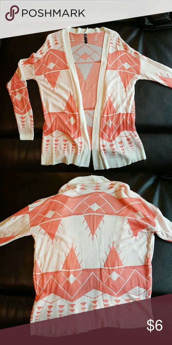 Tribal Cardigan Size is M/L but I would say more a Medium.  Colors are coral and cream and this is a very thin material and there are a few minor snags in the material Debut Sweaters Cardigans