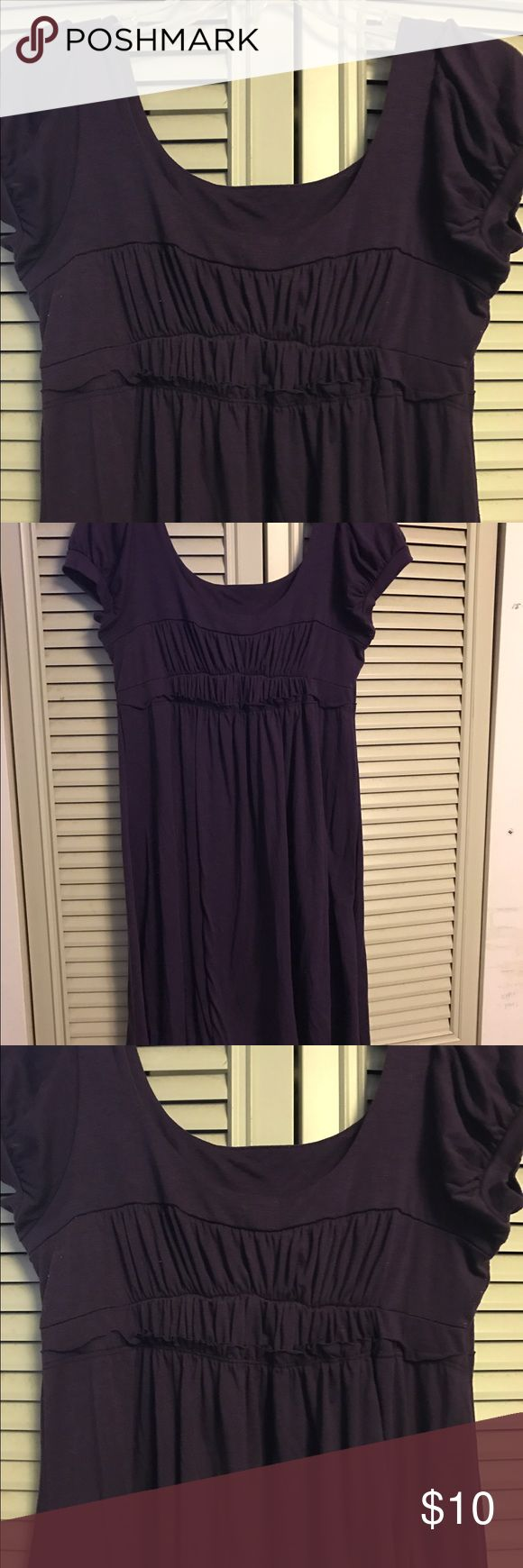 Delias Dress The purple Delias dress was worn before. It's in good condition. Great for wearing out to concerts and semi formal dinners. The length stops below knee. It's short sleeved. Material cotton. Make DELIAS. DELIAS Dresses
