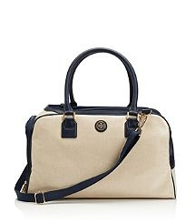 Tory Burch Coated Canvas Dog Carrier.  Designed for small to medium breeds, this sportif satchel features every creature comfort and is the perfect gift for the sophisticated pet lover. Airline-approved sizing, a mesh top and side openings, and two-way zippers for maximum visibility, breathability and ease of use.