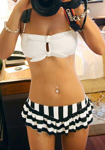 Model with pierced belly button wearing stripe keyhole bikini set