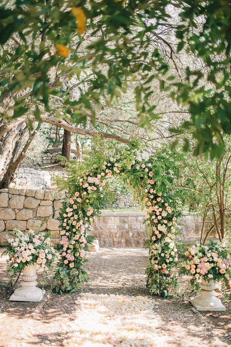 ceremony arch covered in greenery and roses | Photography: Sonya Khegay   sonyakhegay.com Venue: Aman Sveti Stefan   www.aman.com/resorts/aman-sveti-stefan Event Planning: Special Wedding   specialwedding.ru/ Floral + Event Design: Flowerslovers   instagram.com/flowerslovers.ru/   View more: http://stylemepretty.com/vault/gallery/55332
