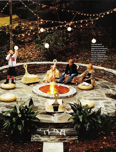 love this outdoor fire pit, lights and patio