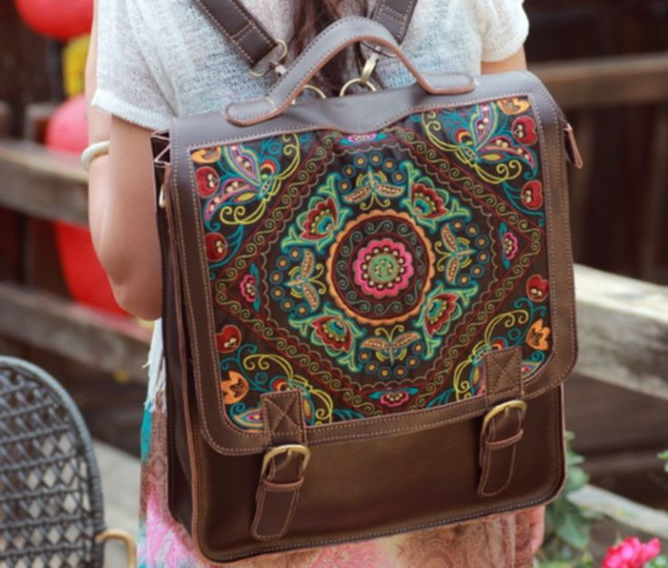 Leather bag / backpack bag with colorful embroidery. Available in different leather colors and embroidery pattern. $199.00, via Etsy.