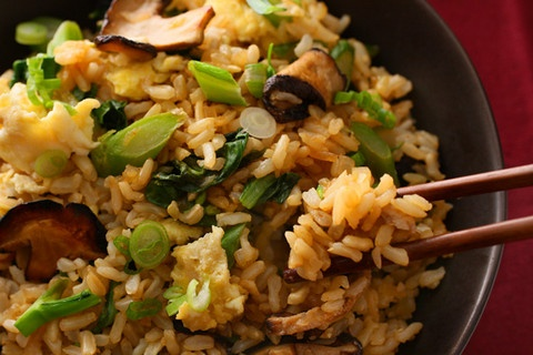 Gai Lan and Shiitake Stir-Fried Brown Rice...Brown rice gets a flavorful Asian twist with soy sauce, mushrooms, eggs, and Chinese broccoli.