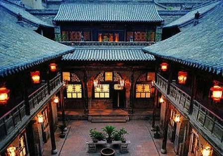 Siheyuan, traditional four sided homes, with central courtyard.  Multigenerational families would reside together in the various wings of the home.