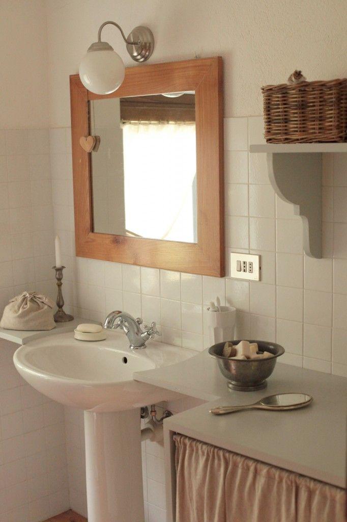 Nascondere la lavatrice e dare al bagno un aspetto più elegante e raffinato.