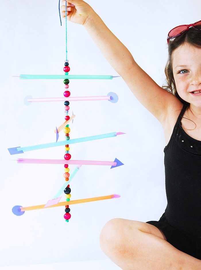 Make a simple mobile from straws and explore the concept of the center of gravity.