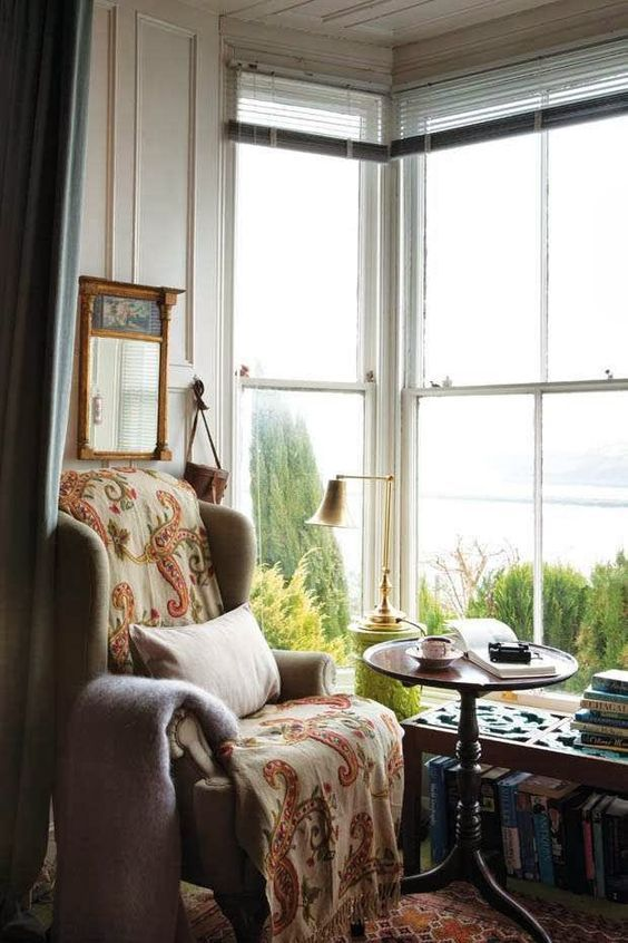 This corner reading nook is a lovely, sunny place to spent an afternoon reading.