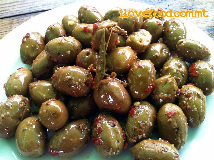 Mix everything in a bowl and crush them to make a whole mixture. Then add the olive oil to make it softer. Fill the olives with this mixture.