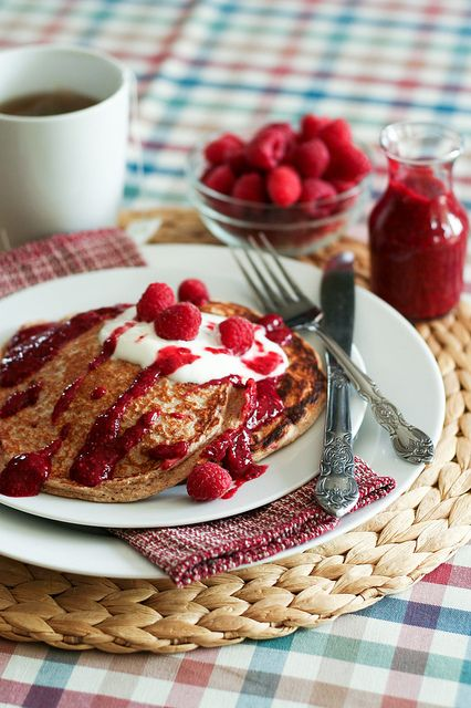 Raspberry Oatmeal Protein Pancakes -   ½ cup Rolled Oats ½ cup 1% Cottage Cheese ½ cup Egg Whites ¼ tsp Baking Powder ¼ tsp Cinnamon ¼ cup frozen (or fresh) raspberries  For the Raspberry Sauce ¾ cup frozen (or fresh) raspberries 1 tbsp unpasteurized liquid  honey 1 tbsp chia seeds ¼ cup water 1 tsp lemon juice