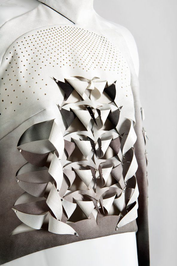 Structural fabric manipulation for fashion with an artful use of perforation, cut, fold  repetition - innovative textiles; 3D surface design // Anne Sofie Madsen