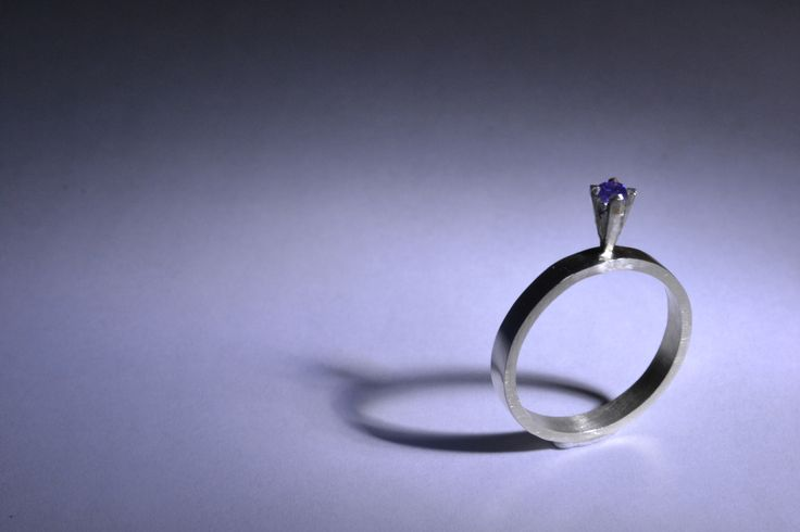 Sterling silver solitaire ring with purple cubic zirconia.