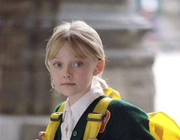 Photos From Dakota Fanning S Best Roles E Online Dakota Fanning Dakota Uptown Girl