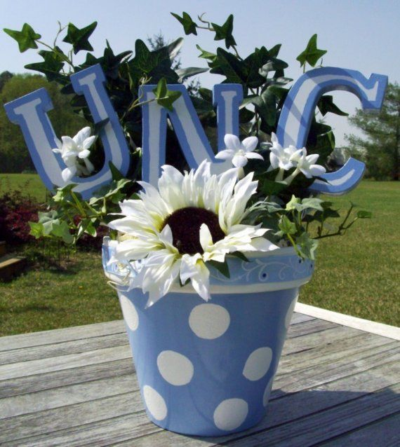 Cute decorations for College/Master's graduation party Buy clay pots, paint blue, use Bingo marker; girls Initials