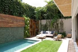 Backyard oasis, pool greens, drought tolerant grass, waterfall