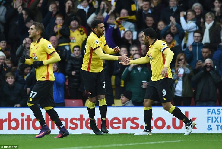The French midfielder pays respect to Watford captain Troy Deeney (right) who provided the assist
