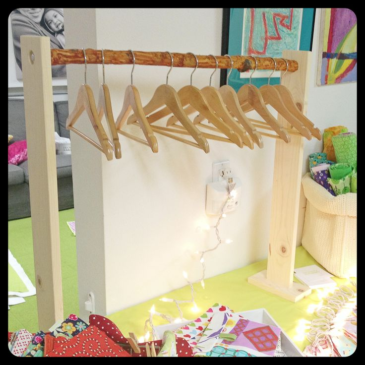 Easy branch rack for our craft show booth setup (table top). This is a mini one that holds small children's hangers, click on for a picture of the larger one.