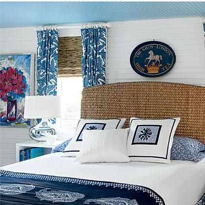 Great beach house headboard idea: this naturally woven headboard sets a beachy vibe paired with navy blue accents. Coastalliving.com