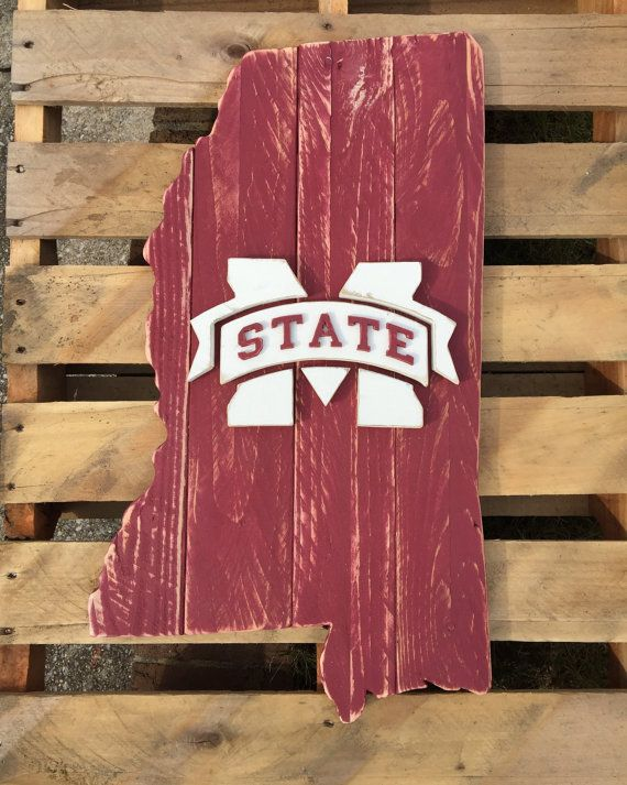 Another unique creation from the original state sign company in Birmingham, AL finally being offered on Etsy. This is the state shape of Mississippi cut from reclaimed wood or pallets. It is painted maroon and features a white Mississippi State logo in the center. The back has a strong