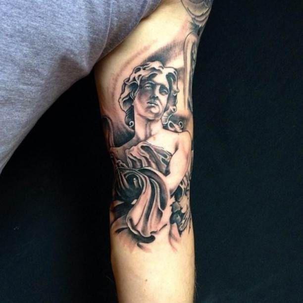 Upper arm tattoo angel in black   #Tattoo, #Tattooed, #Tattoos