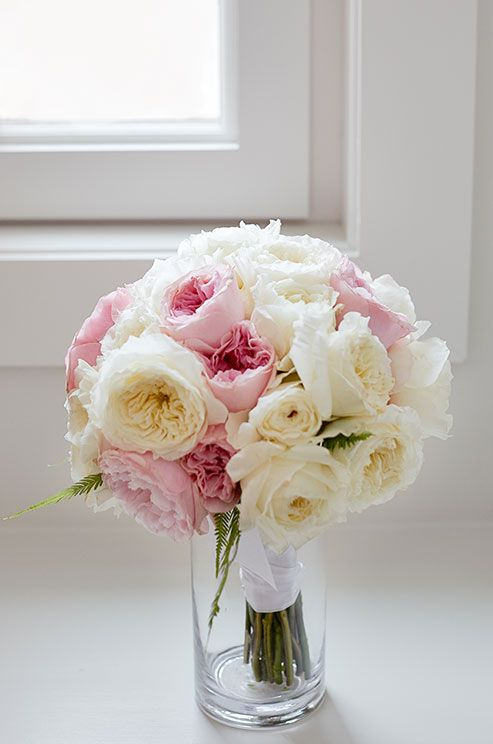 This romantic bouquet features soft pink and white garden roses.