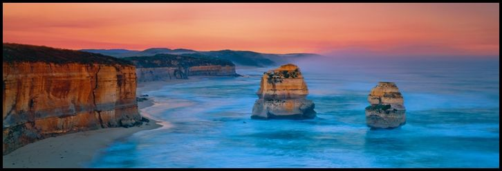 """United We Stand - Gibson Steps, Victoria, Australia. These two limestone stacks stand united, like warriors, ready to face the days challenges. They are symbols of absolute strength, forever going to battle against the wild seas and winds of the Southern Ocean. All has crumbled around them, but they fight on, withstanding all that mother nature can throw at them, every day, for thousands of years.   Please """"Pin"""" """"Share"""" """"Like"""" """"Comment"""" All welcome!"""