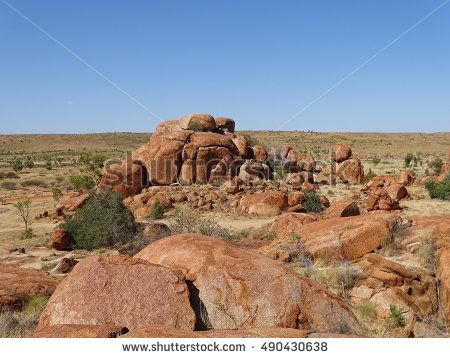 The dry rock outcrop of red rocks in the Australian outback