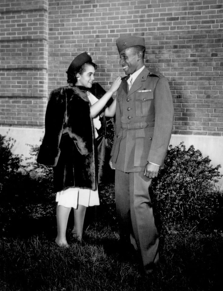 "Caption: ""The first Negro to be commissioned in the Marine Corps has his second lieutenant's bars pinned on by his wife. He is Frederick C. Branch of Charlotte, NC."" November 1945."