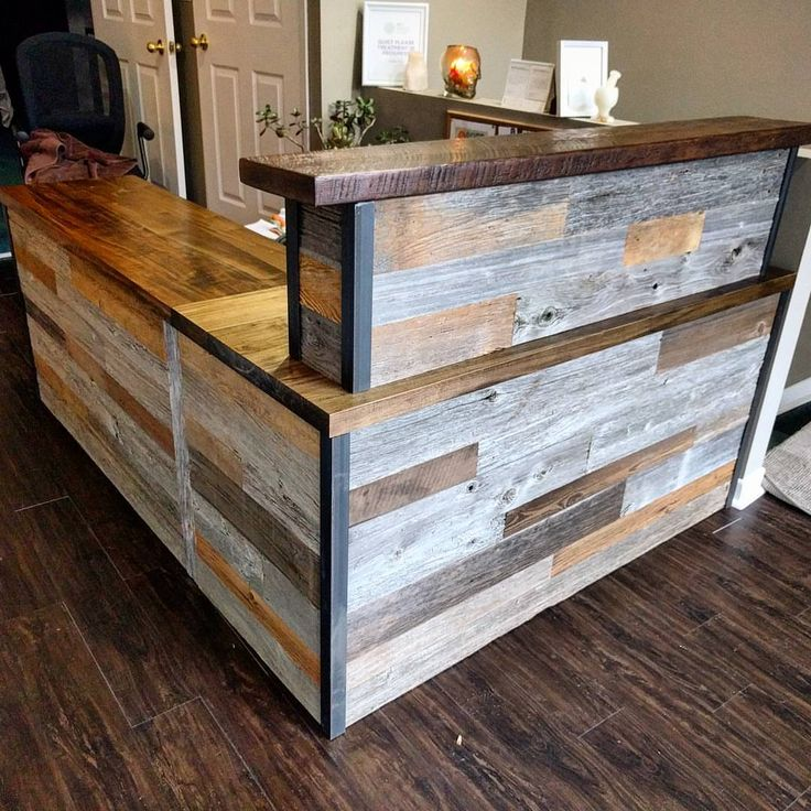 Reclaimed barn board reception desk by barnboardstore - this was done for 360 Healing Centre in Toronto and incorporated 100 plus year old barn board along with metal trim and ambrosia maple tops