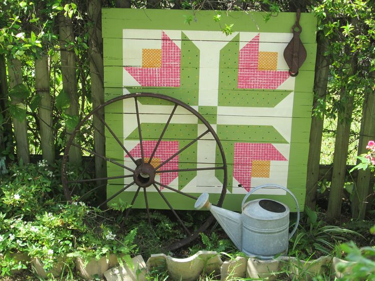Pallet art - Barn quilt I painted on a pallet and put in our garden. This is the view from our kitchen window