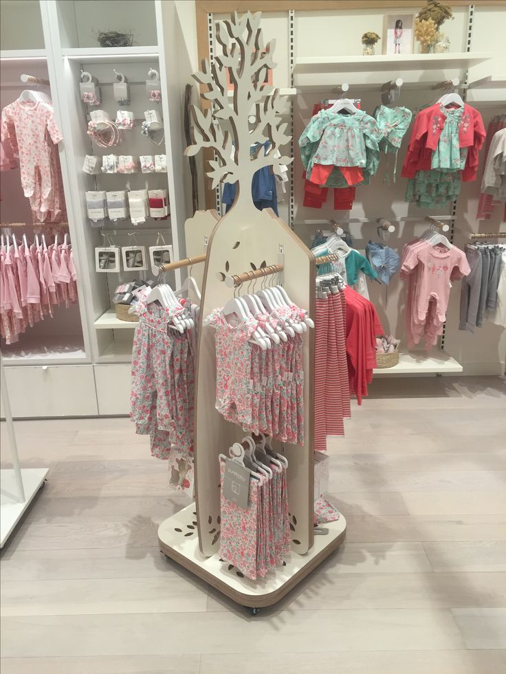 Timber tree stand display for Purebaby