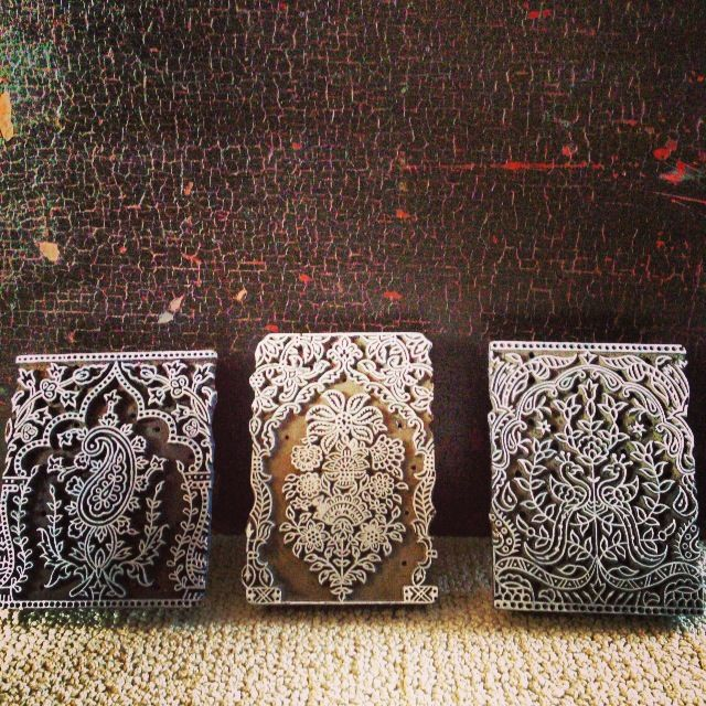 Wooden printing blocks from India with arch patterns.