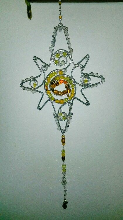 Star sun catcher beaded wire wrapped with angel bead on bottom.