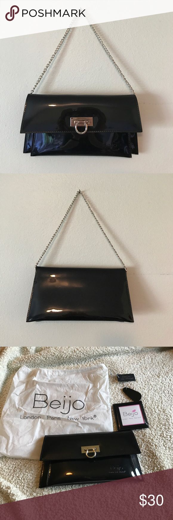 Beijo handbag/clutch Beijo handbag/clutch. This purse can be use as a clutch or a shoulder bag. This bag is in like new condition with original dust cover, photo cards and tags. Beijo Bags Clutches & Wristlets