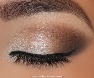 shimmery white eye shadow on my lid just below my crease and surrounded it with dark brown and gray colors