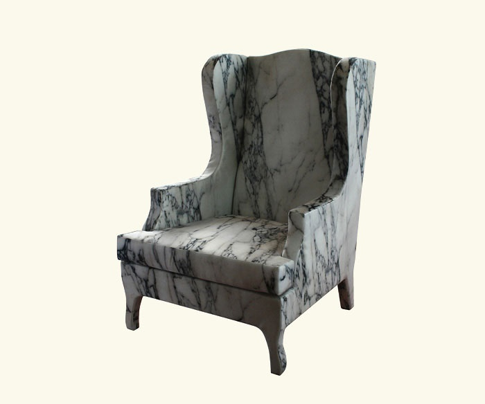 From Cerruti Beleri's line Louis XV Goes to Sparta, this armchair may look like hard slabs of cold marble, but is actually made of soft materials with a photo of marble printed on silk which is stretched over the top.  The effect is perfect.