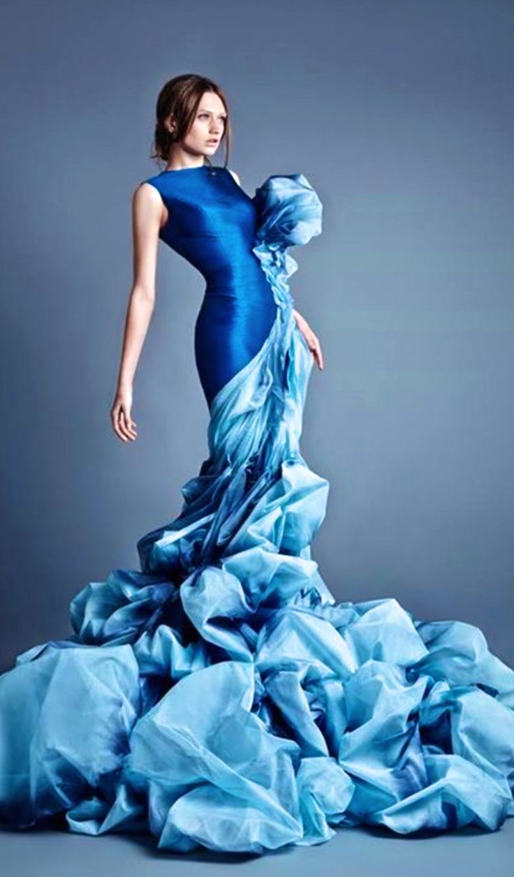This dress was created by Jean Louis Sabaji. This links closely to my idea of water transformation through in is smooth across her body but comes crashing down at the bottom which looks like a waterfall.