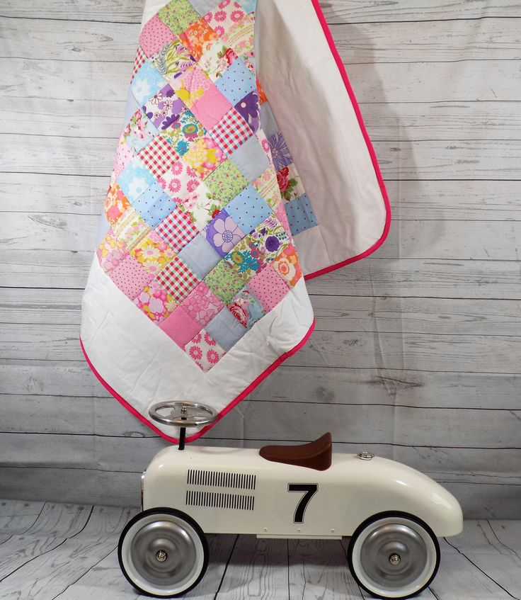 A personal favourite from my Etsy shop https://www.etsy.com/uk/listing/241031932/patchwork-quilt-baby-quilt-flower-baby