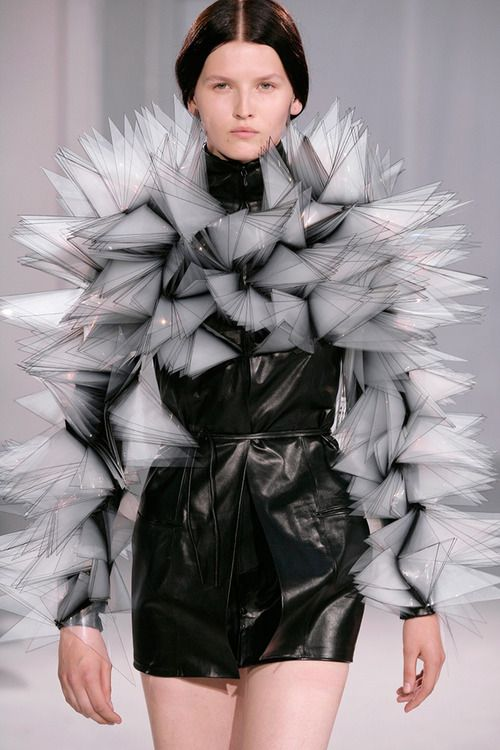 Iris van Herpen is young fashion designer from the Netherlands know for her embrace of contemporary high technologies, from new materials to advanced, computer-controlled production techniques. Her approach is  sculptural and experimental and in the tradition of body-artist fashion designers such as the late Alexander McQueen whose theatrical, performative approach she has learned from.