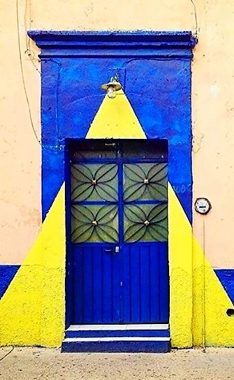 Unique blue and yellow door in Oaxaca, Mexico.