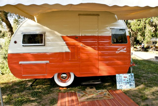 Gorgeous ivory & tangerine Shasta. A vacation home on wheels. Why be tied down to a place?