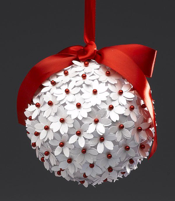 Red & White Paper-Punch Ornament / Supplies: foam ball, white paper, red ball tipped pins and ribbon.